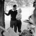 Newlyweds Marilyn Monroe and Arthur Miller are clearly in love as they both look longingly into each other's eyes after their wedding ceremony at Miller's White Plains New York home June 30th, 1956. Arthur's left arm is around Marilyn's waist with his right arm holding a cigarette against a tree. Other photographers can be seen snapping photos in this black and white image taken by Milton H Greene.