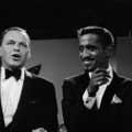 Taken during the filming of Sammy Davis Jr television show in 1966 by Milton H Greene. Frank Sinatra is the guest and is to the right of Sammy talking as Sammy smiles.